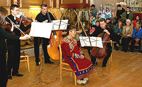 Pacific Rim Music Festival 2004: Ensemble XXI musicians performing Pia Siirala's composition with Nivkh national singer, Lydia Muvchik, at the Nogliki Ethnic Museum  on Sakhalin